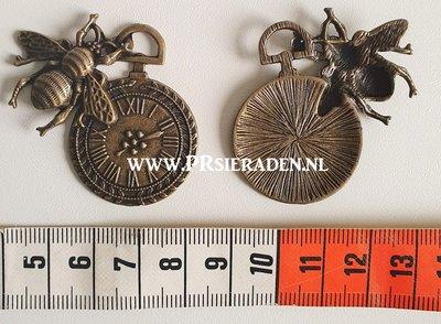 Klok met bij bronskleurige bedel