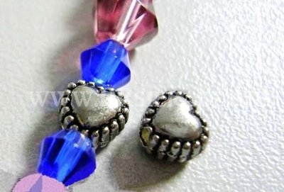 Metalen hart kraal