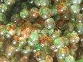 Groen-oranje-spraypainted-glaskralen